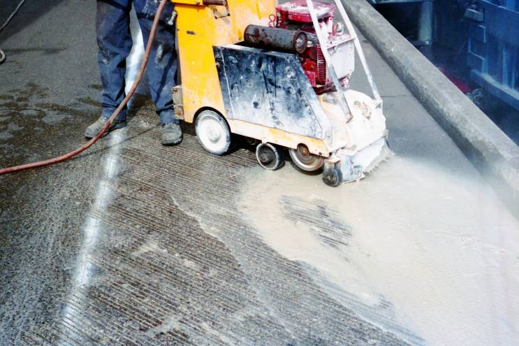 Diamond grooving is used to add traction and aid drainage to slippery slabs.