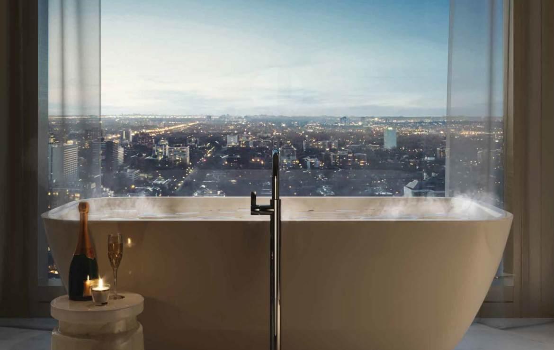 Rendering of 50 Scollard Yorkville Condos suite luxury bath by window.