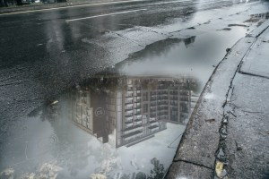 Reflection of Stockyards District Condos in a puddle.