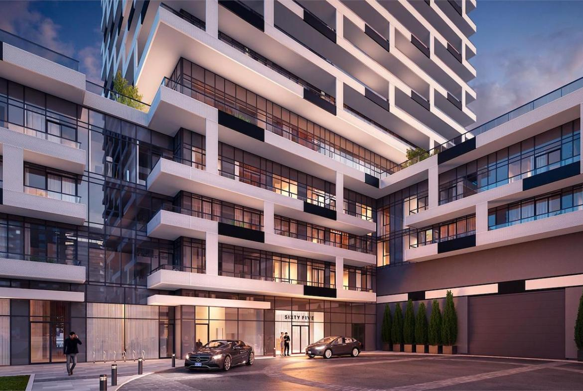 Exterior rendering of Sixty-Five Broadway Condos entrance in the evening.