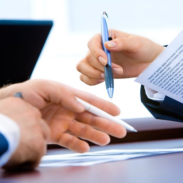 Woman and man going through legal real estate documents together.