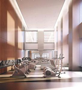 Rendering of SkyTower condos fitness centre with exercise machines.