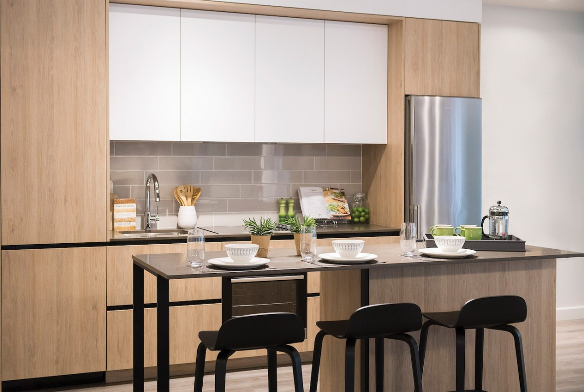 Rendering of Artsy Condos suite interior kitchen with island seating.