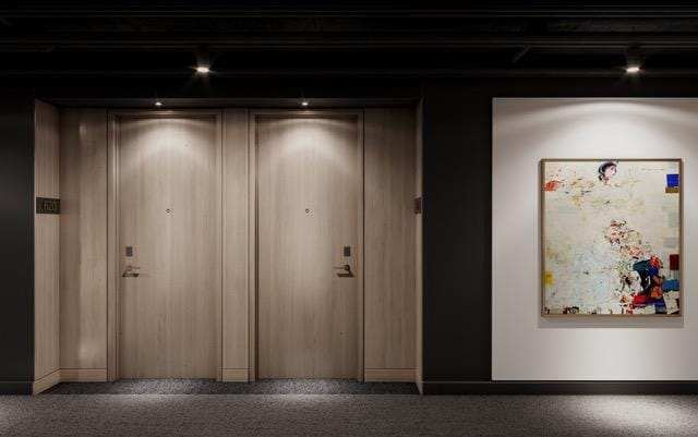 Rendering of The Carvalo on College Condos unit corridor with light wood architectural features.