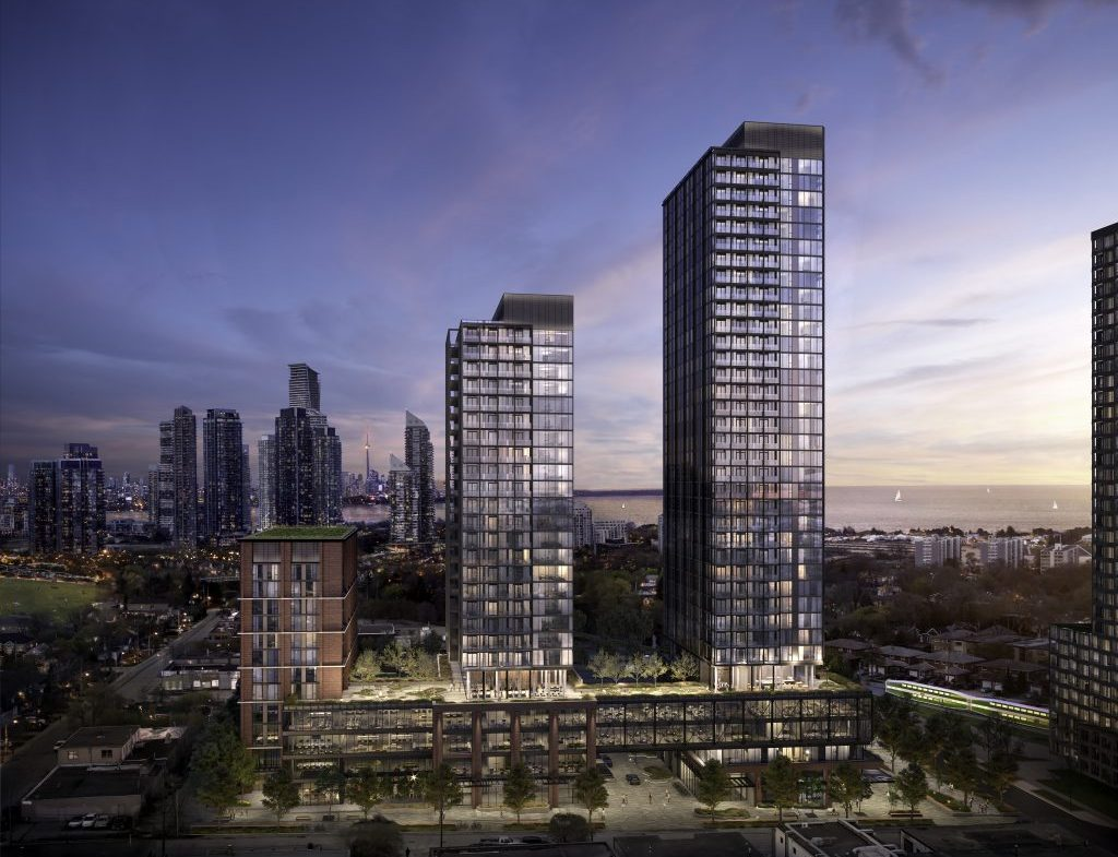 Exterior rendering of Grand Central Mimico Condos towers at night.