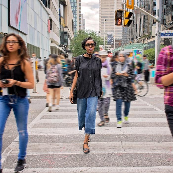 Woman Walking in Downtown Toronto, Canada.