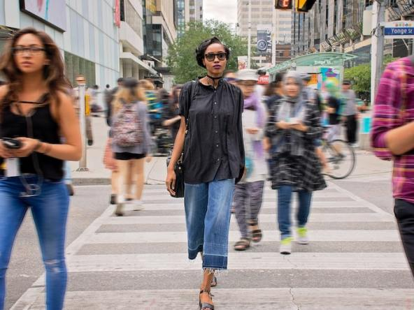 Woman Walking in Downtown Toronto, Canada.