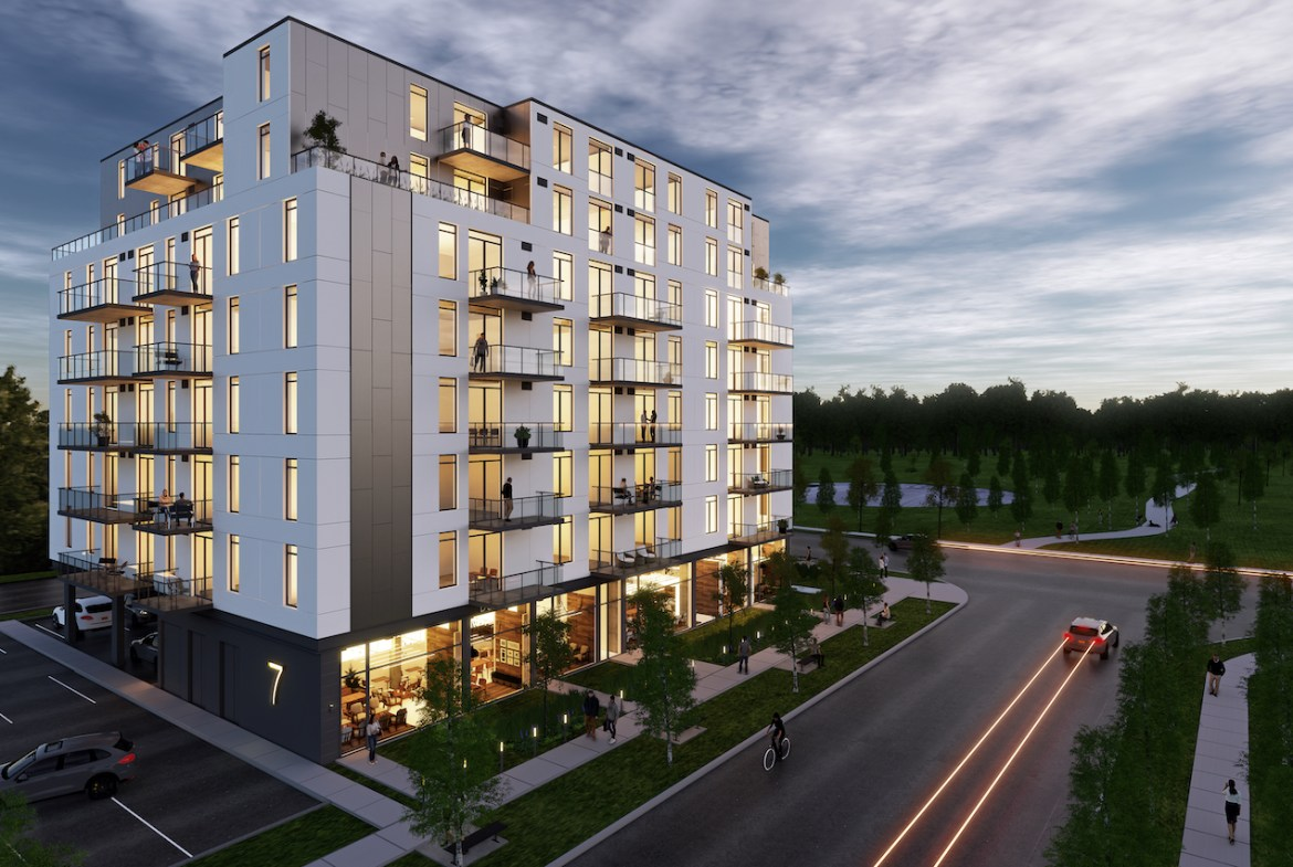 Rendering of Grand Bell Condos exterior at night.