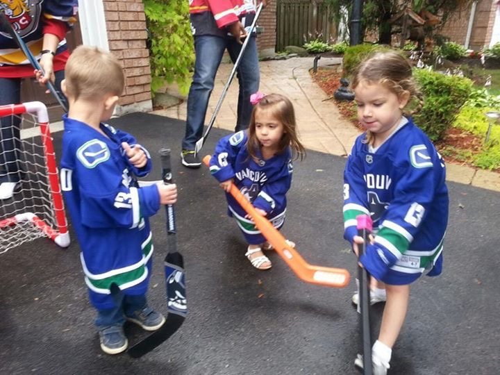 Grandchildren playing hockey