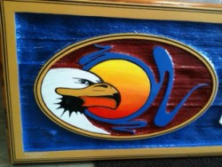 Detail of the Eagle on the sandblasted cedar sign for Shuswap insurance in Enderby BC.Condor systems vernon bc