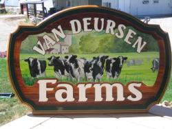 Dairy farm advertising cedar sign