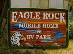 Eagle Rock Mobile Home & R.V. Park Armstrong BC. custom made handcrafted sand blasted cedaer sign by Condor Signs Vernon BC.