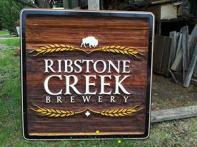 Ribstone Creek Brewery Alberta,artist painted hancrafted sand blasted cedar sign for craft brewery,business cedar signs by Condor signs Vernon BC,Edmonton, Calgary