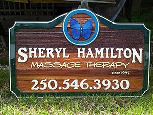 Sheryl Hamilton massage therapy,Armstrong BC,quality hand crafted artist painted sand balsted cedar sign,business cedar sign,butterfly on sign,green border,