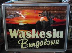 sandblasted development sign for Waskesiu Bungalows Prince Albert National Park in northern Sask.