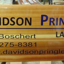 Davidson Pringle Lawyers cedar wood golf course ad board
