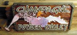 Champagne Powder Chalet at Big White before repair and restoration by Condor Signs Vernon BC