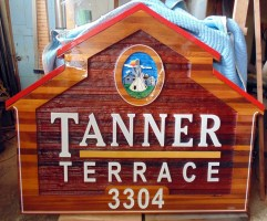 Sandblasted cedar sign for Vernon Native Housing Tanner Terrace artist painted ,handcrafted by Condor Signs Vernon BC