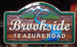 Sandblasted cedar sign Custom designed and constructed for Brookside development in Whitehorse NWT Canada.Condor Signs/systems ships signs anywhere.