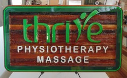wooden sign sandblasted for Thrive physiotherapy Vernon BC. Condor signs