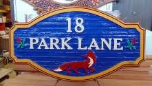 PEI wooden sign sandblasted and artist painted by Vernon sign maker Condor Signs