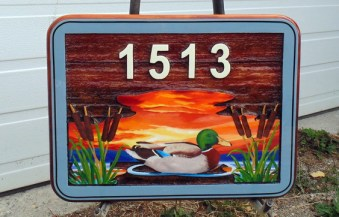 Sandblasted cedar sign with a mallard duck for SasK.by Condor signs Vernoon bc