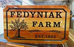V carved cedar sign for Fedyniak Farm in Vernon BC by Condor Signs