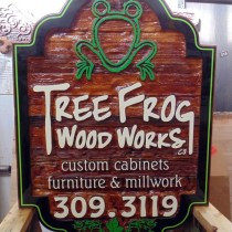 Tree Frog wood works Vernon BC.This sign is bought back to life with a small restoration by Condorsigns Vernon BC