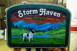 Storm Haven Acres Vancouver Island breeders of champion pit bulls.This sign was created,artist painted,sandblasted by Condor Signs Vernon BC.s