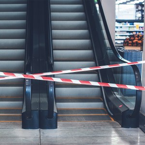 mall escalator is blocked off with tape due to closure