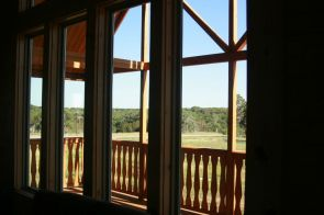 log home interior with prowl glass window
