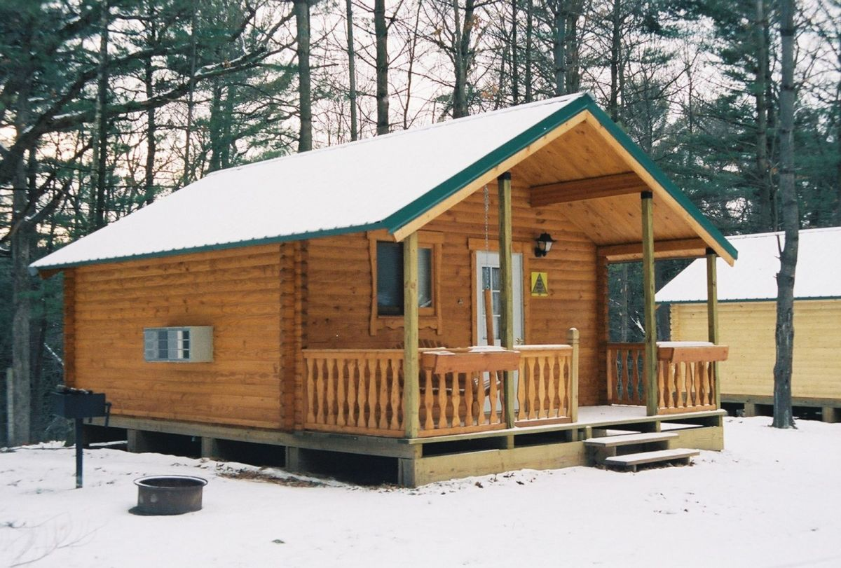 camp log cabin bunkhouse in snow