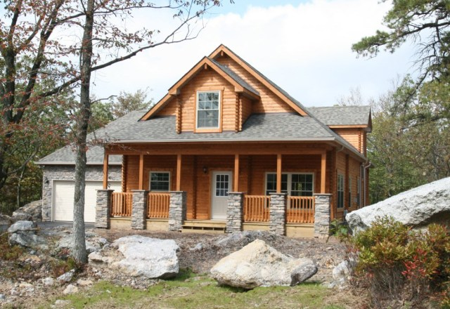 custom log home front view with garage