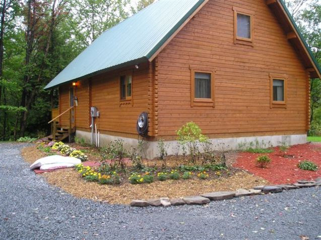 log building wall exterior stain