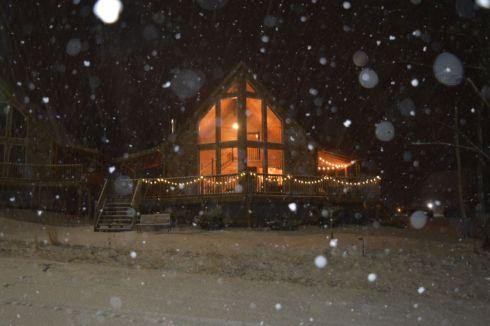 Alpine Ridge log home in snow storm