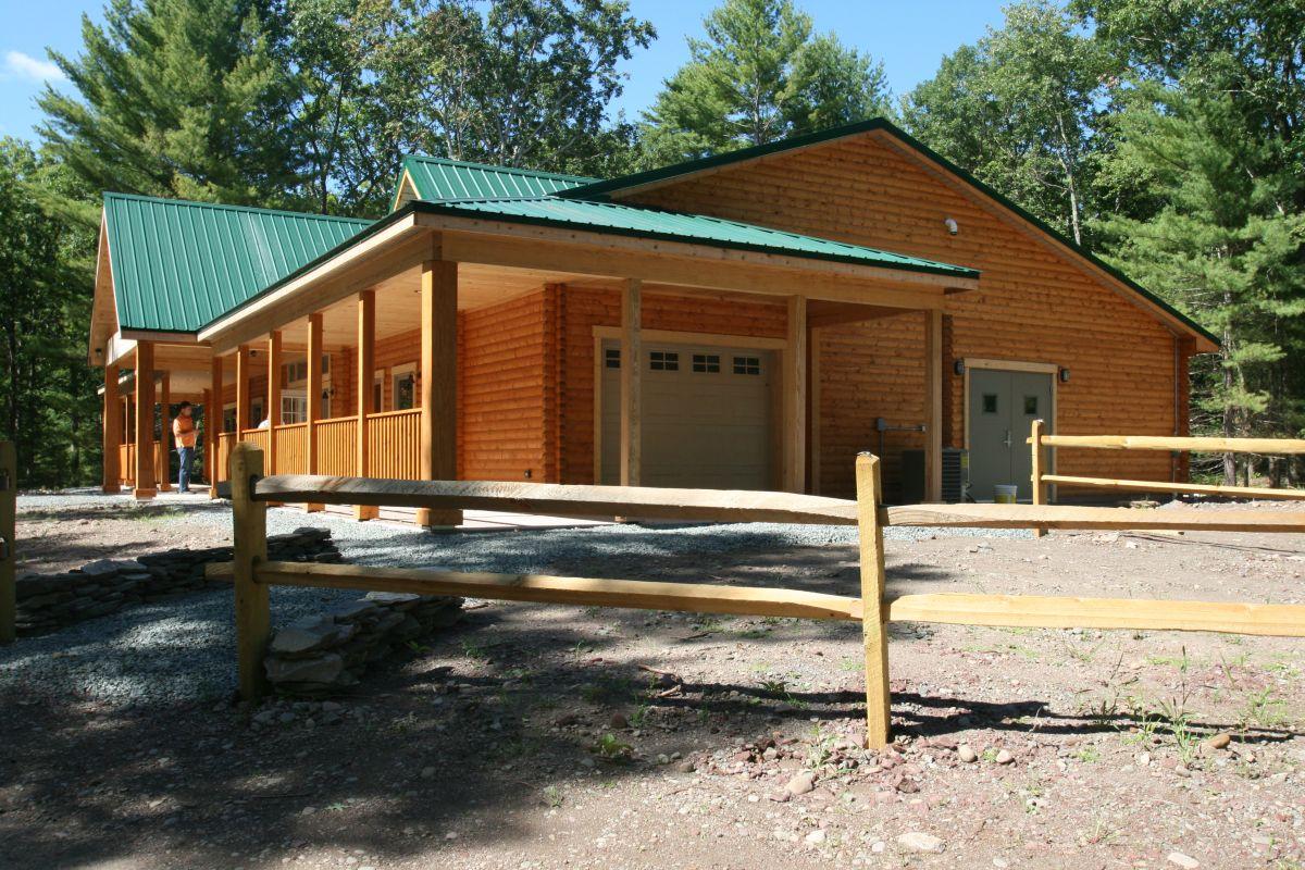 Huron multi-purpose log cabin building side