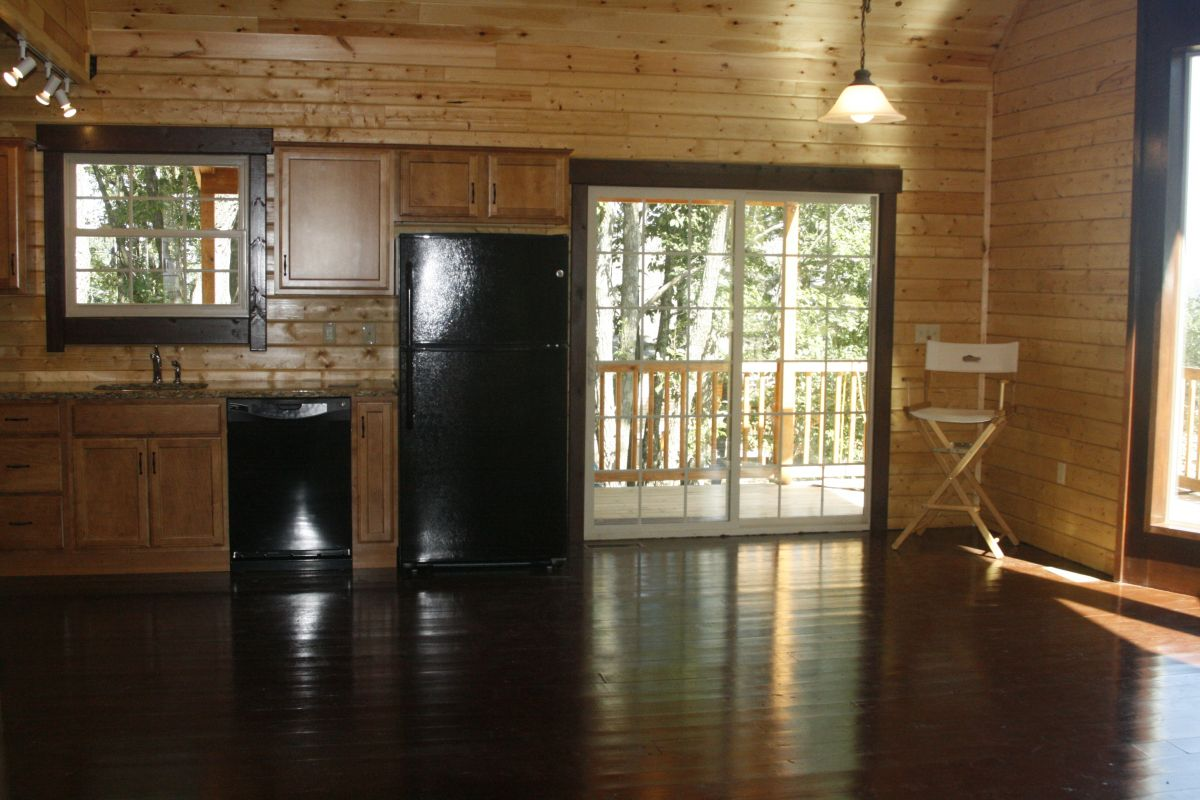 Sugarloaf log home kit kitchen and dining area