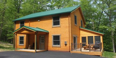 bear den log home front