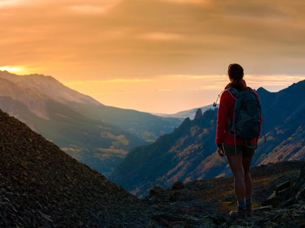 Backpacker Girl Looking at Beautiful Sunset Colorado Mountains Ophir Pass