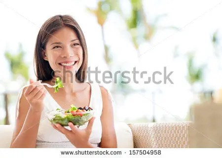stock-photo-healthy-lifestyle-woman-eating-salad-smiling-happy-outdoors-on-beautiful-day-young-female-eating-157504958