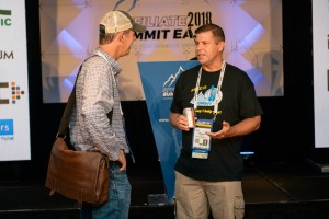 Shawn Collins chatting with a conference attendee