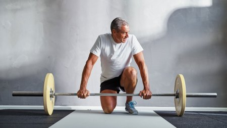 senior man exercising with weights