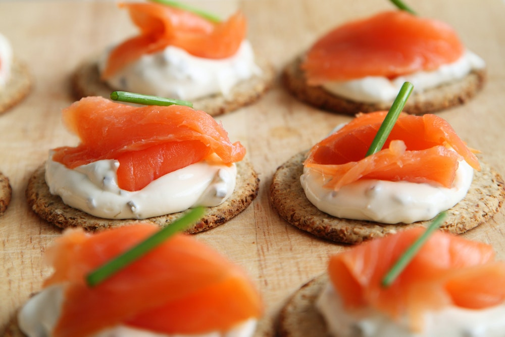 Salmon canapes sitting on a table