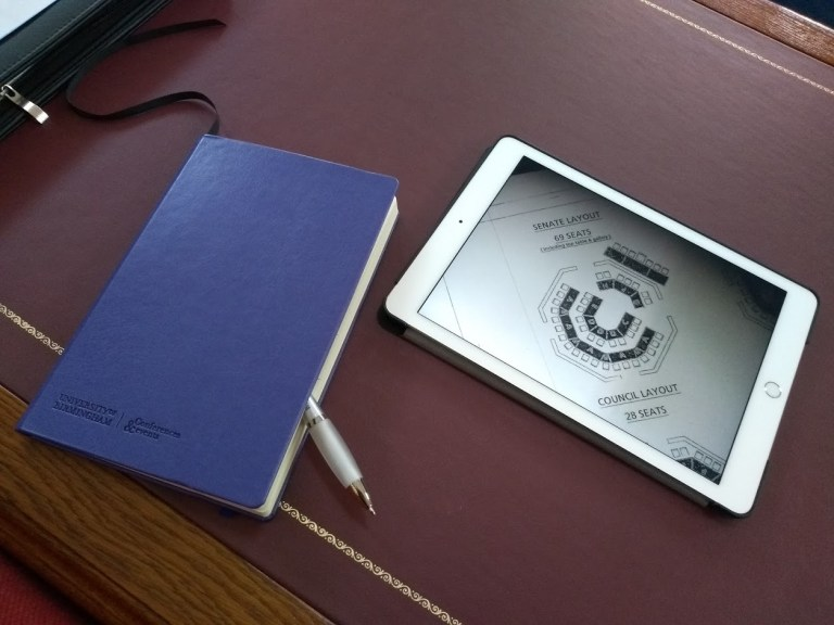 Note book and ipad on a desk