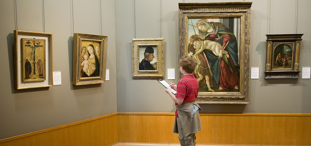 Child looking at historic artwork