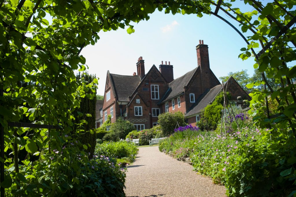 View of Winterbourne house through the nutwalk