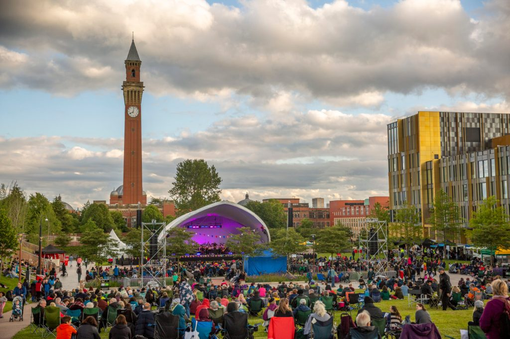 Hundreds of people sat outside at the Green Heart for an event. The Green Heart will be a key venue to engage people with the B2022 Commonwealth Games.