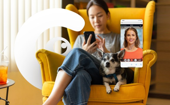 customer engagement using video commerce. A woman is sitting down along with her dog engaging with a video call on an eCommerce platform