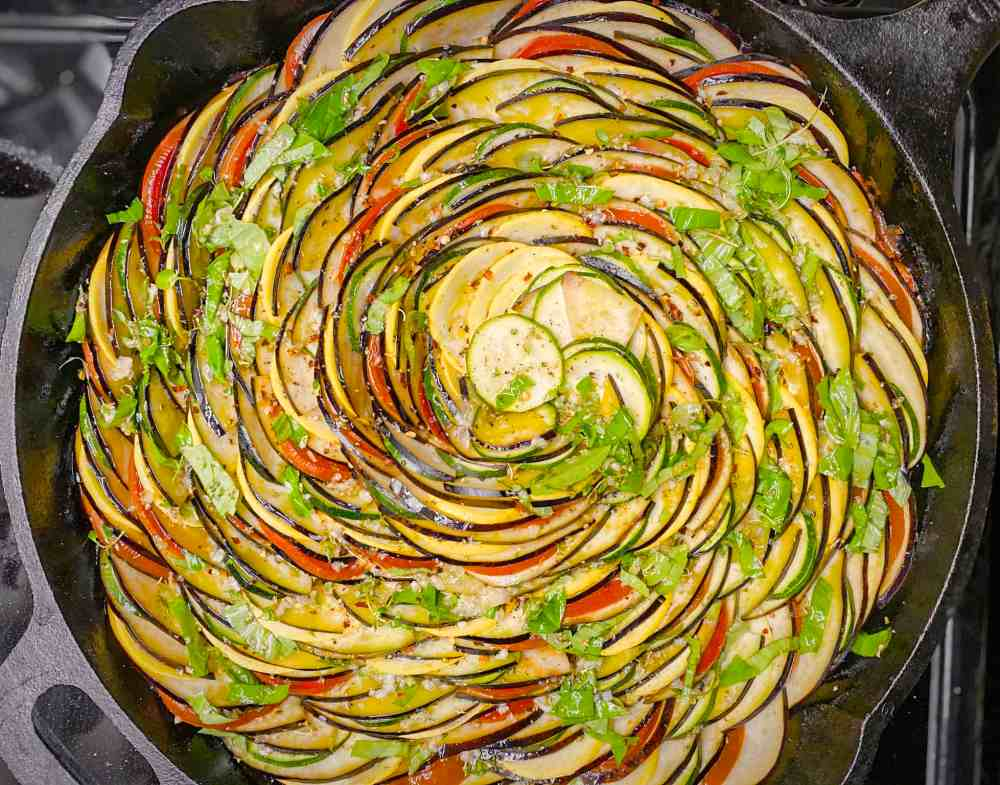 Ratatouille brushed with garlic basil flavored olive oil before baking. In a cast iron skillet.