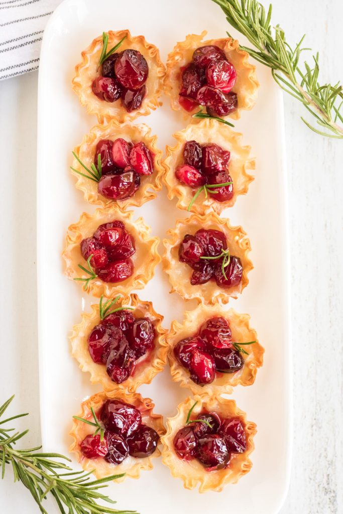 Cranberry brie bites are the perfect addition to your next holiday party! These simple cranberry brie appetizers are so easy to prep, but look like you slaved all day in the kitchen!